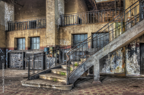 Imposing staircase inside the hall of an abandoned power plant