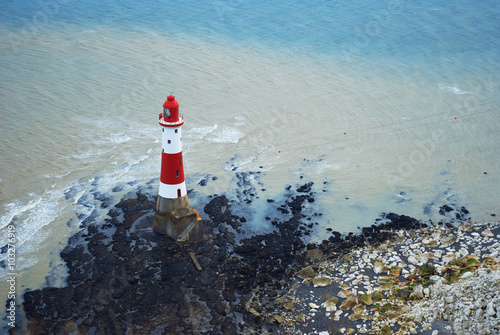Fotografie, Obraz  Lighthouse at the foot of the Beachy Head cliff, UK.