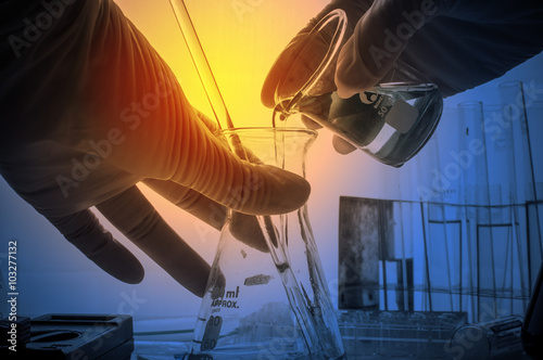 science laboratory test tubes with periodic table background