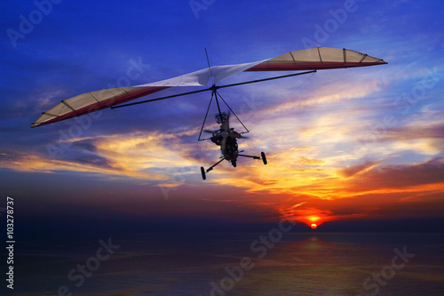 Hang glider in the sunset
