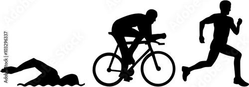 Fotografiet  Triathlon silhouettes