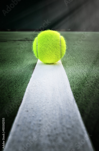 Tennis ball on tennis court Poster