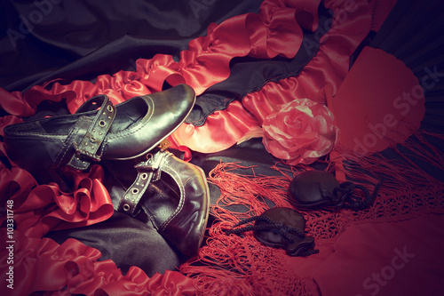 Cadres-photo bureau Carnaval Clothing for Flamenco dance. Black shoes, red scarf with tassels, paper rose and castanets are lying on a black and red dress. Edited as a vintage photo with intentionally dark edges.