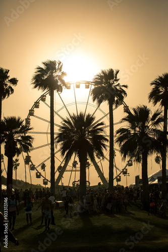 Ferris Wheel Sunset. Ferris wheel in Coachella California caught in a sand storm at sunset.