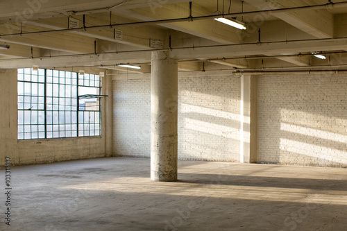 Modern Loft Apartment Warehouse Interior. Clean And Modern Empty Industrial Warehouse  Interior In California Without