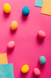 Leinwanddruck Bild - Easter eggs on pink paper