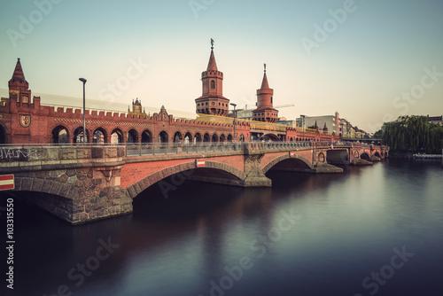 historical Oberbaum bridge (Oberbaumbruecke) and the river Spree in Berlin, Germ Poster