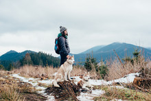 Female Hiker With Siberian Hus...