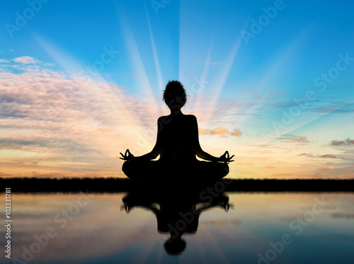 Fotografie, Obraz  Silhouette of a girl practicing yoga