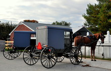 Lancaster County, Pennsylvania - October 14, 2015:  Amish Buggies Pulled By Horses Parked Outside A Local Supply Store *