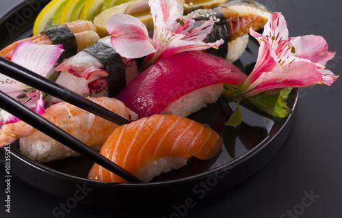 Printed kitchen splashbacks Sushi bar Sushi set on a black plate and black background
