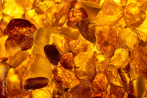Tableau sur Toile closeup baltic amber stones lie on a flat surface