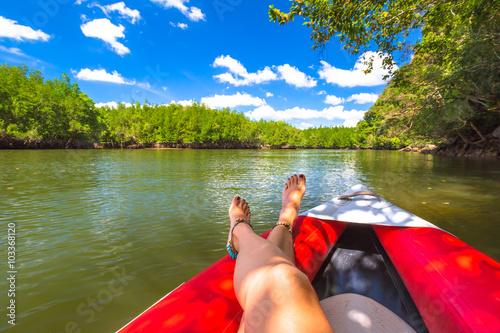 Fényképezés Tanned legs on kayak