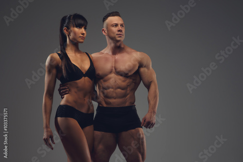 Spoed Foto op Canvas Fitness Fitness couple isolated on a grey background.