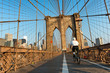 Cyclist Riding on Brooklyn Bridge Pedestrian Path