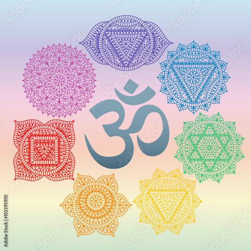 Fotografie, Obraz  Set of seven chakras and symbol OM in the centre