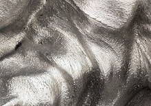 Background Texture Of The Shining Metal Surface. The Curved Plate Is Made Of Iron.