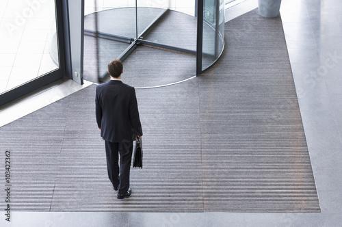 Fotografie, Tablou  A businessman leaving office