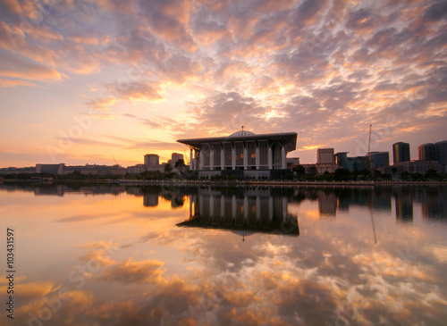 Wall Murals Bali PUTRAJAYA, MALAYSIA - Beautiful summer sunrise at Tuanku Mizan Zainal Abidin Mosque. Also known as Iron Mosque, mosque in Putrajaya, Soft Focus due to Long Exposure Shot. Copy Space Area