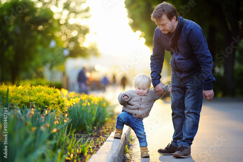 Valokuva  Father and his son at summer park