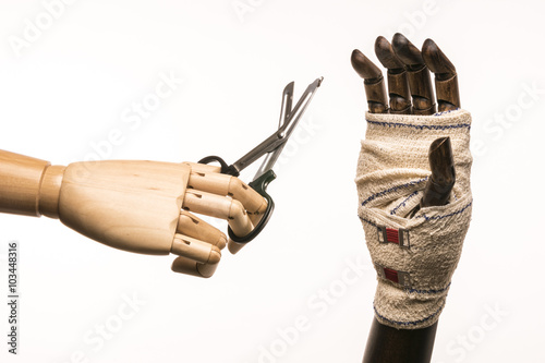 Rugged hand, scissors, bandage and care  Isolated on white