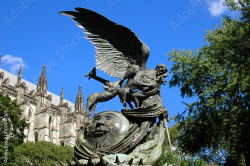 Fotografie, Obraz  New York City - August 26, 2004:  The 1985 Peace Fountain by sculptor Gregg Wyatt stands in the gardens at the Cathedral Church of St