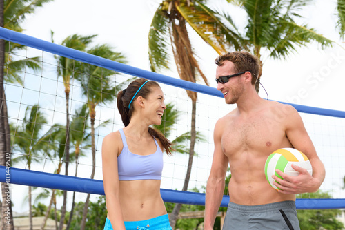 fototapeta na drzwi i meble Beach volleyball. People playing having fun in sporty active lifestyle portrait holding volley ball after game in summer. Woman and man fitness model living healthy lifestyle doing sport on beach.