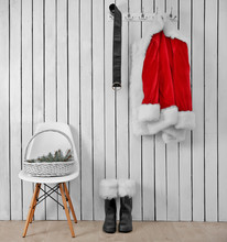 Santa Jacket, Boots And Belt On A Wooden White Wall
