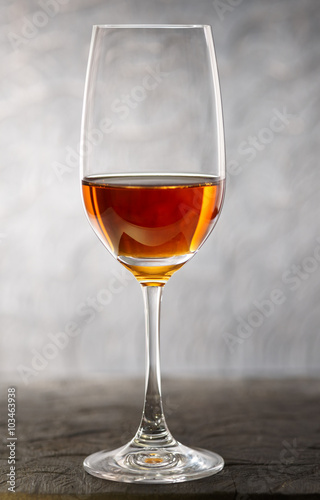 Canvas Print Glass of amontilliado sherry on wooden plank