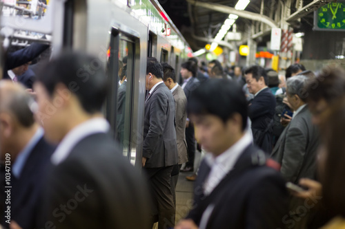 Passengers traveling by Tokyo metro.