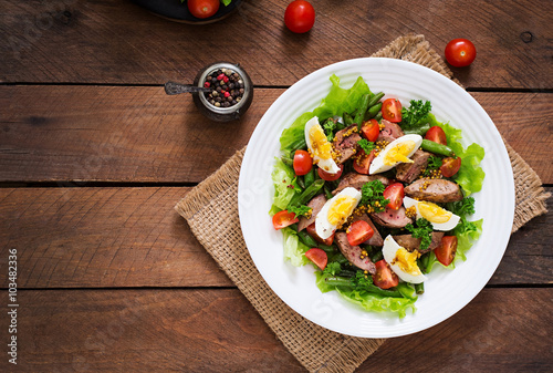 Warm salad with chicken liver, green beans, eggs, tomatoes and balsamic dressing Canvas Print