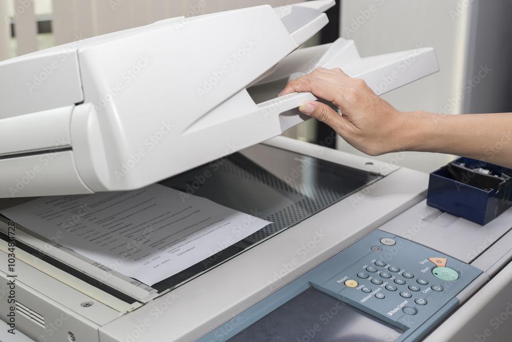 Fototapety, obrazy: woman opening a photocopier