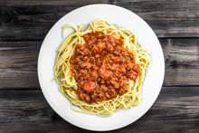 Cooked Spaghetti Bolognese On White Plate.