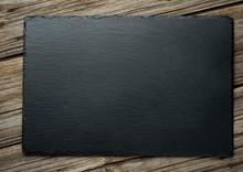 Slate Over Old Wooden Background