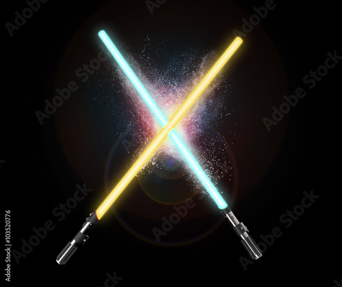 Photo  two light sabers crossing together isolated on black