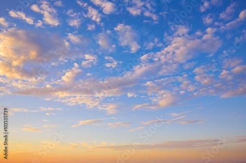 Tuinposter Canarische Eilanden Sunset sky with golden and blue clouds