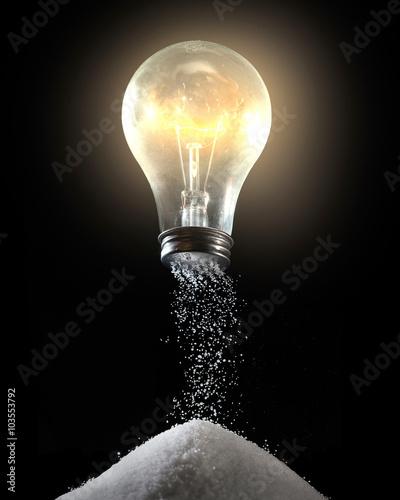 Photo  Light bulb and salt shaker