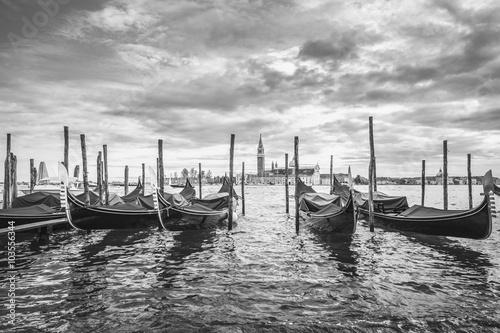 Gondolas in lagoon of Venice and San Giorgio island in background, Italy, Europe, black and white