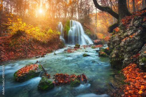 Montage in der Fensternische Wasserfalle Beautiful waterfall at mountain river in colorful autumn forest with red and orange leaves at sunset. Nature landscape