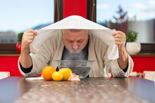 Mature Man With Colds And Flu. Inhalation Of Herbs