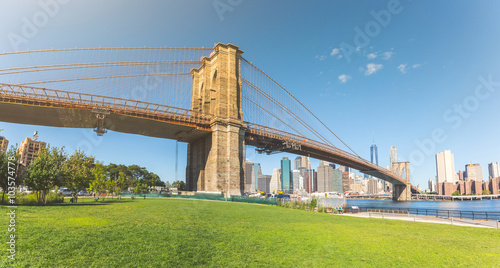 Brooklyn bridge with New York downtown on background