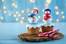 Christmas Cupcakes With Candies On Wooden Stand, Closeup