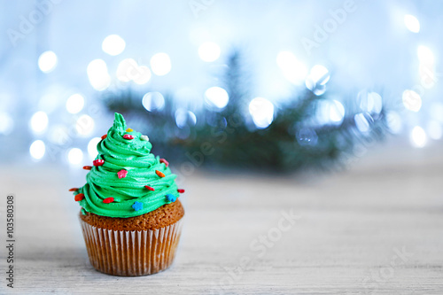 Christmas cupcake with lights on background Canvas Print