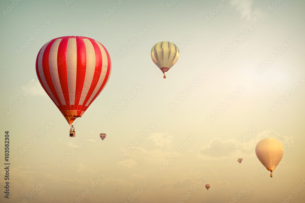Hot air balloon on sun sky with cloud, vintage and retro filter effect style