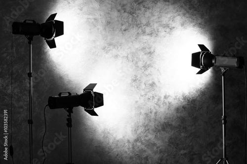 Foto op Canvas Licht, schaduw Studio light flashes on wall grey textured background