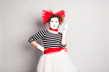 Woman Mime  Talking On Her Cell Phone
