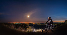 Cross Country Biker On Top Of ...