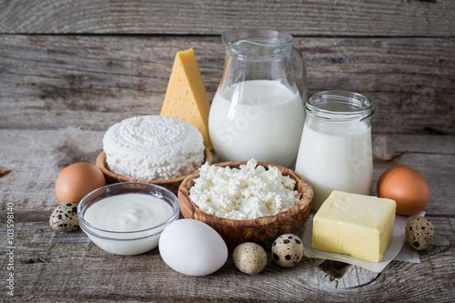 Poster Dairy products Selection of dairy products on rustic wood bacground