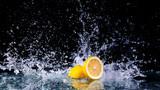 Sliced lemon in the water on black background