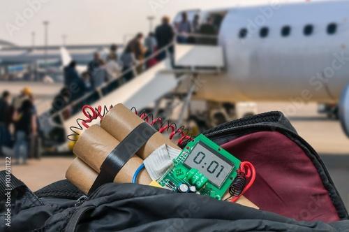Fotografía  Dynamite bomb in bag in airport. Terrorism concept.